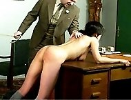 Tearful school girl slides down her knickers and bends over the desk - severe cane stripes and welts