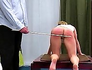 European chic in white gets bent over a table and caned brutally