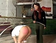 School gir's humiliating toch toes caning - deep stripes and welts on full round buttocks