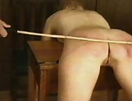 Headmistress and Teacher take turns paddling and spanking two sluts supple backsides